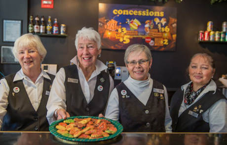 Volunteers with Christmas Cookies at the Capitol Theatre