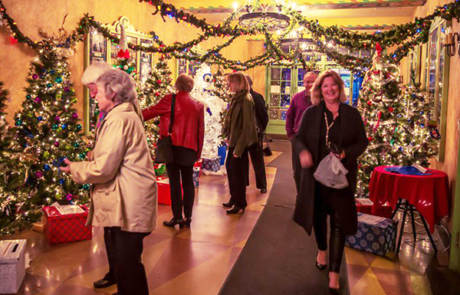 People Viewing the Christmas Trees in the Lobby of the Capitol Theatre